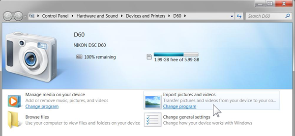 How do I import photos from my camera to my Windows 7